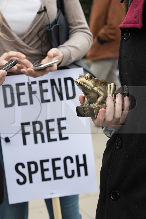 """© Licensed to London News Pictures. 11/03/2018. London, UK. A man with a frog statuette which he described as representing the alt-right icon Pepe . Alt right group Generation Identity and other far-right groups hold a demonstration at Speakers' Corner in Hyde Park , opposed by antifascists . Generation Identity supporters Martin Sellner and Brittany Pettibone were due to speak at the demo but were arrested and detained by police when they arrived in the UK , also forcing them to cancel an appearance at a UKIP """" Young Independence """" youth event , which in turn was reportedly cancelled amid security concerns . Photo credit: Joel Goodman/LNP"""