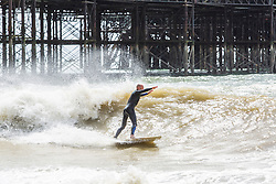 © Licensed to London News Pictures. 28/04/2019. Brighton, UK. Jet-skiers and surfers taking part in their hobby alongside the Brighton Palace Pier in Brighton and Hove. Photo credit: Hugo Michiels/LNP