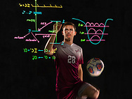 Oliver Harris '19, is a midfielder with the Colgate Raiders men's soccer team and poses for a portrait with chemistry equations, December 5, 2018 in Hamilton, N.Y.<br /> Mark DiOrio / Colgate University