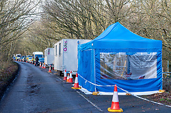 "© Licensed to London News Pictures. 11/12/2019. Gerrards Cross, UK. Police vehicles alongside portable cabins at the scene in Gerrards Cross in Buckinghamshire as the Metropolitan Police Service continue to search woodland. Police have been in the area conducting operations since Thursday 5th December 2019. In a press statement issued on 7th December, a Metropolitan Police spokesperson said ""Officers are currently in the Gerrards Cross area of Buckinghamshire as part of an ongoing investigation.<br /> ""We are not prepared to discuss further for operational reasons."" Photo credit: Peter Manning/LNP"