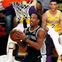 LOS ANGELES, CA - OCT 22: San Antonio Spurs guard DeMar DeRozan (10) goes for the reverse layup during a game on October 22, 2018 at the Staples Center in Los Angeles, California.