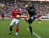 Photo: Olly Greenwood.<br />Charlton Athletic v Manchester City. The Barclays Premiership. 04/11/2006. Charlton's Andy Reid and Manchester City's Ben Thatcher.