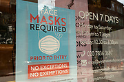 Masks required, no exceptions sign in a shop window on 2nd July 2021 in London, United Kingdom. Now that the roadmap for coming out of the national lockdown and easing of restrictions is set, dome medical professionals are suggesting thatsome safety measures are kept in place because of the increase in the Delta variant.