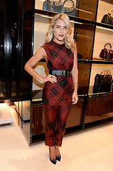 MOLLIE KING at a party hosted by Gucci & Clara Paget to drink a new cocktail 'I Bamboo You' held at Gucci, 34 Old Bond Street, London on 16th October 2013.
