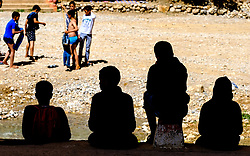 A group of boys enjoying a Sunday afternoon at Todra Gorge, Morocco<br /> <br /> (c) Andrew Wilson | Edinburgh Elite media
