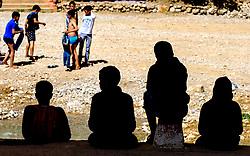 A group of boys enjoying a Sunday afternoon at Todra Gorge, Morocco<br /> <br /> (c) Andrew Wilson   Edinburgh Elite media