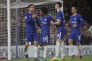 Marcos Alonso, Willian Borges, Gary Cahill and Davide Zappacosta of Chelsea celebrate with Willian of Chelsea (22) after he scores his teams 4th goal from a penalty . <br /> Premier league match, Chelsea v Stoke city at Stamford Bridge in London on Saturday 30th December 2017.<br /> pic by Kieran Clarke, Andrew Orchard sports photography.