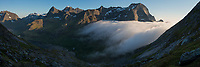 Summer fog creeps over mountain pass towards Vindstad, Moskenesøy, Lofoten Islands, Norway
