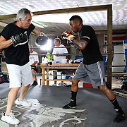 """WINTER HAVEN, FL - MAY 05: Boxer Willie Monroe Jr. (R) trains with Danny Akers at the Winter Haven Boxing Gym on May 5, 2015 in Winter Haven, Florida. Monroe will challenge middleweight world champion Gennady """"GGG"""" Golovkin for the WBA world championship title in Los Angeles on May 16.  (Photo by Alex Menendez/Getty Images) *** Local Caption *** Willie Monroe Jr.; Danny Akers"""
