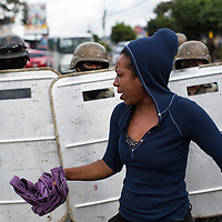 Soldiers of the Honduran Army on the streets of the capital Tegucigalpa repel a protest against electoral fraud in Tegucigalpa.