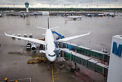 THEMENBILD - Airport Muenchen, Franz Josef Strauß (IATA: MUC, ICAO: EDDM), Der Flughafen Muenchen zählt zu den groessten Drehkreuzen Europas, rund 100 Fluggesellschaften verbinden ihn mit 230 Zielen in 70 Laendern, im Bild eine Maschine der Lufthansa, Typ Airbus A330-300 am Terminal dahinter Ansicht des Flughafen Gelaendes // THEME IMAGE, FEATURE - Airport Munich, Franz Josef Strauss (IATA: MUC, ICAO: EDDM), The airport Munich is one of the largest hubs in Europe, approximately 100 airlines connect it to 230 destinations in 70 countries. picture shows: a machine of the Lufthansa Airbus A330-300 at the airport terminal behind this view of the airport Munich, Munich, Germany on 2012/05/06. EXPA Pictures © 2012, PhotoCredit: EXPA/ Juergen Feichter