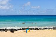 Swimmers off of a beach in Kauai, Hawaii.