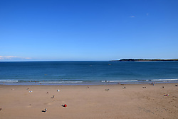 South beach, Tenby, Pembrokeshire, South Wales July 2021. Caldey Island in the distance