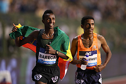 BRUSSELS, Sept. 1, 2018  Selemon Barega (L) of Ethiopia celebrates after the men's 5,000m race at the IAAF Diamond League athletics meeting in Brussels, Belgium, Aug. 31, 2018. Selemon Barega claimed the title in a time of 12 minutes and 43.02 seconds. (Credit Image: © Zheng Huansong/Xinhua via ZUMA Wire)