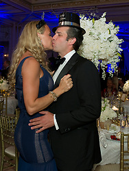 123116 PBDN Meghan McCarthy Vanessa and Donald Trump Jr. kiss after midnight during a New Year's Eve celebration at Mar-a-Lago Club Saturday December 31, 2016 in the Town of Palm Beach.