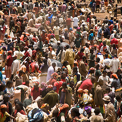 People crowd into  an open market beside the last stetch of paved road south of Arba Minch.