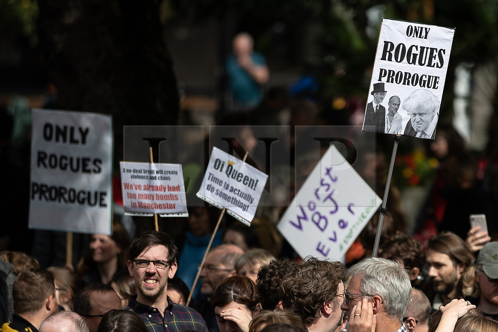 """© Licensed to London News Pictures. 31/08/2019. Manchester, UK. Placards reading """" Only rogues prorogue """" and """" Worst BJ ever """" . Thousands attend a pro EU demo in Albert Square in Manchester City Centre , with objections raised to the Prime Minister Boris Johnson's intention to prorogue Parliament in the run up to Britain's planned Brexit deadline . Photo credit: Joel Goodman/LNP"""