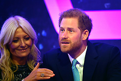 The Duke of Sussex reacts next to television presenter Gaby Roslin as he delivers a speech during the annual WellChild Awards at the Royal Lancaster Hotel, London.