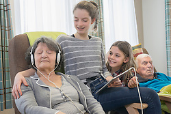 Senior woman and man spending time with grand children in rest home