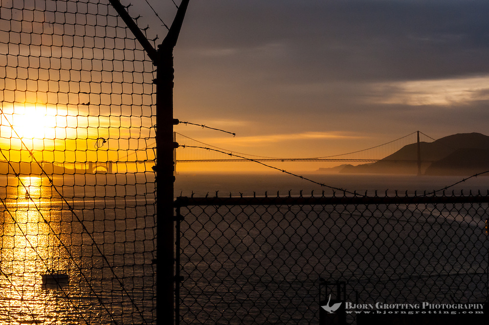 United States, California, San Francisco. Sunset view towards the Golden Gate bridge from Alcatraz.