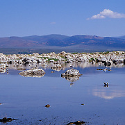 Mono Lake is a large saline and akaline lake in California on the eastern side of the Sierra Nevada Mountains. It is 1,944 m (6,380 ft) above sea level. The lake is in an geologically active area at the north end of the Mono-Inyo Craters volcanic chain.  Geological activity is caused by faulting at the base of the Sierra Nevada, and is associated with the crustal stretching of the Basin and Range Province. The most recent eruption occurred 350 years ago at Paoha Island in Mono Lake.