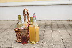 Basket with apple juice and rose wine, Bavaria, Germany