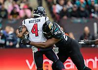 American Football - 2019 NFL Season (NFL International Series, London Games) - Houston Texans vs. Jacksonville Jaguars<br /> <br /> Calais Campbell, Defensive End, (Jacksonville Jaguars) sacks Deshaun Watson, Quarterback,(Houston Texans) at Wembley Stadium.<br /> <br /> COLORSPORT/DANIEL BEARHAM