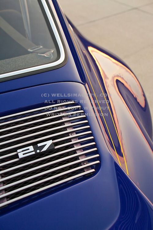 Image of a blue Porsche 911 car detail with grill and rear window