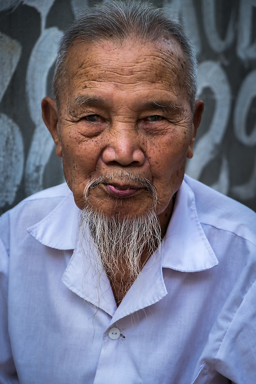 VAN HA, VIETNAM - CIRCA SEPTEMBER 2014:  Portrait of old man at the Lang Gom Tho Ha village. The village belongs to the Van Ha commune, it is located 50km away from Hanoi in Northern Vietman