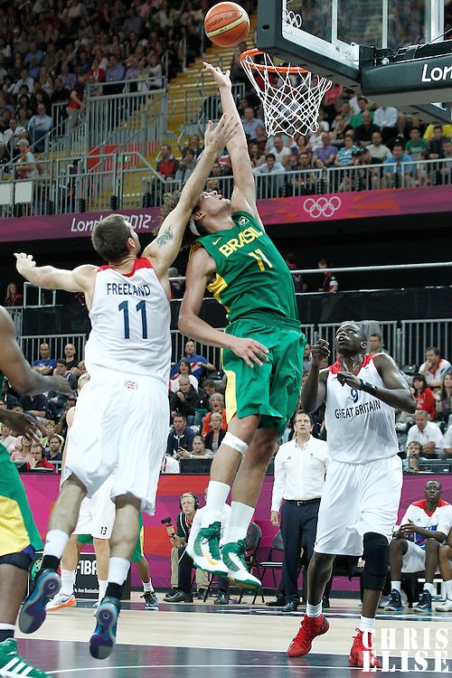 31 July 2012: Brazil Anderson Varejao vies for the rebound with .Joel Freeland during 67-62 Team Brazil victory over Team Great Britain, during the men's basketball preliminary, at the Basketball Arena, in London, Great Britain.
