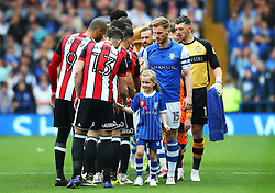 Sheffield Wednesday players shake hands with Sheffield United players before the match - Mandatory by-line:  Matt McNulty/JMP - 24/09/2017 - FOOTBALL - Hillsborough - Sheffield, England - Sheffield Wednesday v Sheffield United - Sky Bet Championship