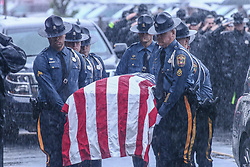 May 5, 2017 - Wilmington, DE, United States of America - Fellow troopers carry the casket of Corporal Stephen J. Ballard during his funeral services held at the Chase Center On The Riverfront in Wilmington Delaware. Ballard was gunned down Wednesday April 26, 2017 in a Bear-area Wawa parking lot when he approached a suspicious vehicle and the passenger jumped out and began firing at him. Ballard fell after being hit, and the shooter continued to fire rounds into the trooper before fleeing to his family's Middletown-area home. (Credit Image: © Saquan Stimpson via ZUMA Wire)