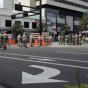 Police officers cross the street in mass during the Republican National Convention in Tampa, Fla. on Wednesday, August 29, 2012. (AP Photo/Alex Menendez)