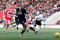 Photo: Paul Thomas.<br /> Doncaster Rovers v Swansea City. Coca Cola League 1. 17/02/2007.<br /> <br /> Ian Craney of Swansea misses this open goal after beatting keeper Ben Smith (R).