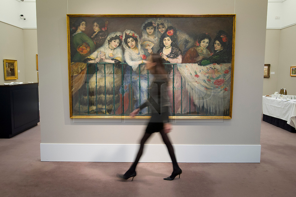 © Licensed to London News Pictures. 16/11/2012. London, UK. A Sotheby's employee walks past 'A Balcony at the Bullfight' (1904) (est. GB£200,000-300,000), a painting by Spanish artist Ricardo Canals, at a press call taking place at the London based auction house's New Bond Street premises today (16/11/12).  The sale, featuring works by 19th century European painters, is set to take place on the 20th of November. Photo credit: Matt Cetti-Roberts/LNP