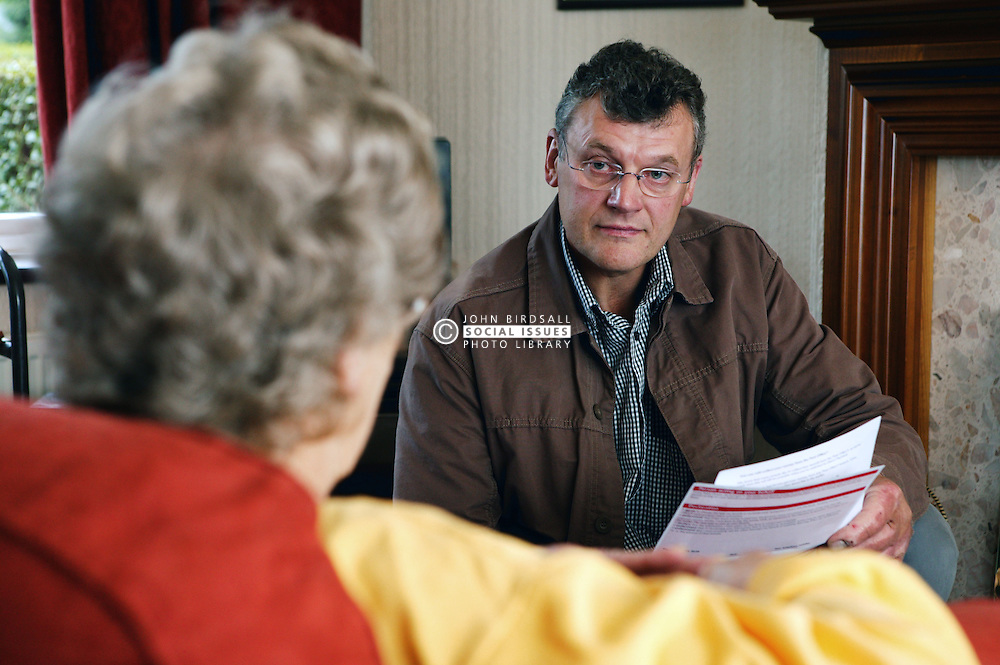 Welfare rights worker consulting with Service User during a home visit,