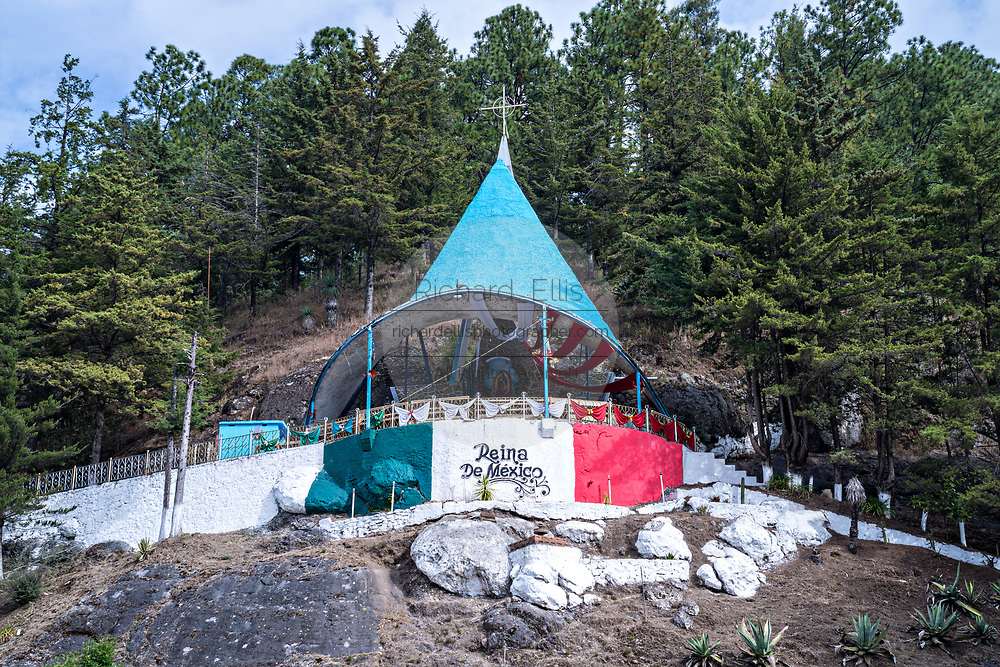 The Reina de México shrine to the Virgin of Guadalupe in Angangueo, Michoacan, Mexico. Angangueo is a tiny, remote mountain town and the entry point to the Sierra Chincua Monarch Butterfly Sanctuary.