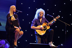 Tomorrow, july 19, it's a Brina May 70th anniversary. Guitar player, singer, composer, Queen's original lineup founder with Freddie Mercury, May's next step are a book of photos in 3d on sale in autumn. File images from 1978 just today. 18 Jul 2017 Pictured: Kerry Ellis and Brian May. Photo credit: Bruno Marzi / MEGA TheMegaAgency.com +1 888 505 6342