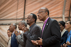 27 October 2019, Addis Ababa, Ethiopia: EECMY president Rev. Yonas Dibisa (right) joins Sunday service at the Finfinne Oromo Mekane Yesus Congregation of the Ethiopian Evangelical Church Mekane Yesus. In a context where congregations did not use to be allowed to hold their services in any language but Amharic, the congregation today is one of some 60 Oromo speaking Mekane Yesus congregations in Addis Ababa. The service takes place on the first Sunday following political turmoil in the country, claiming dozens of lives.