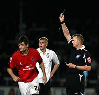 Photo: Mark Stephenson/Sportsbeat Images.<br /> Hereford United v Accrington Stanley. Coca Cola League 2. 24/11/2007.Referee Mr T Kettle shows Accrington's Sean Webb the yellow card while Hereford's Robert Threlfall looks on