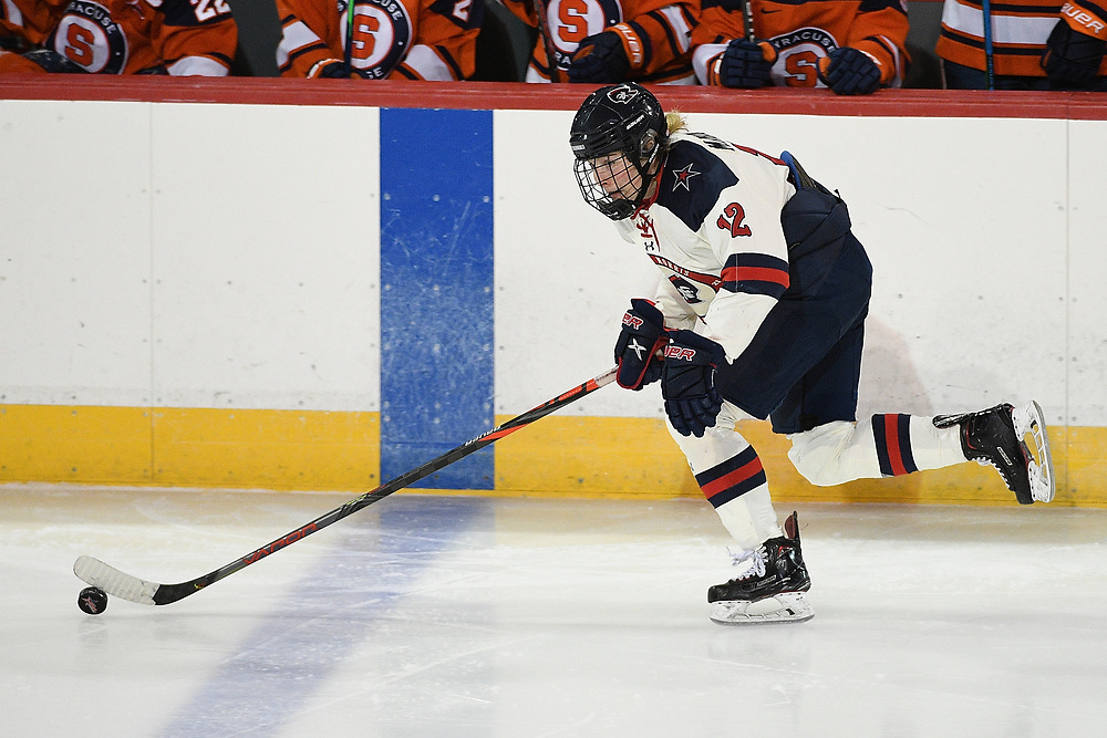 ERIE, PA - MARCH 06: Leah Marino #12 of the Robert Morris Colonials skates with the puck in the third period during the CHA Tournament Championship game against the Syracuse Orange at the Erie Insurance Arena on March 6, 2021 in Erie, Pennsylvania. (Photo by Justin Berl/Robert Morris Athletics)