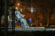 A young couple lay on each other's arms during the mid-night clock of changing the calendar year in the capital city of Armenia, Yerevan on Friday, Jan 1, 2021. (Photo/ Vudi Xhymshiti)