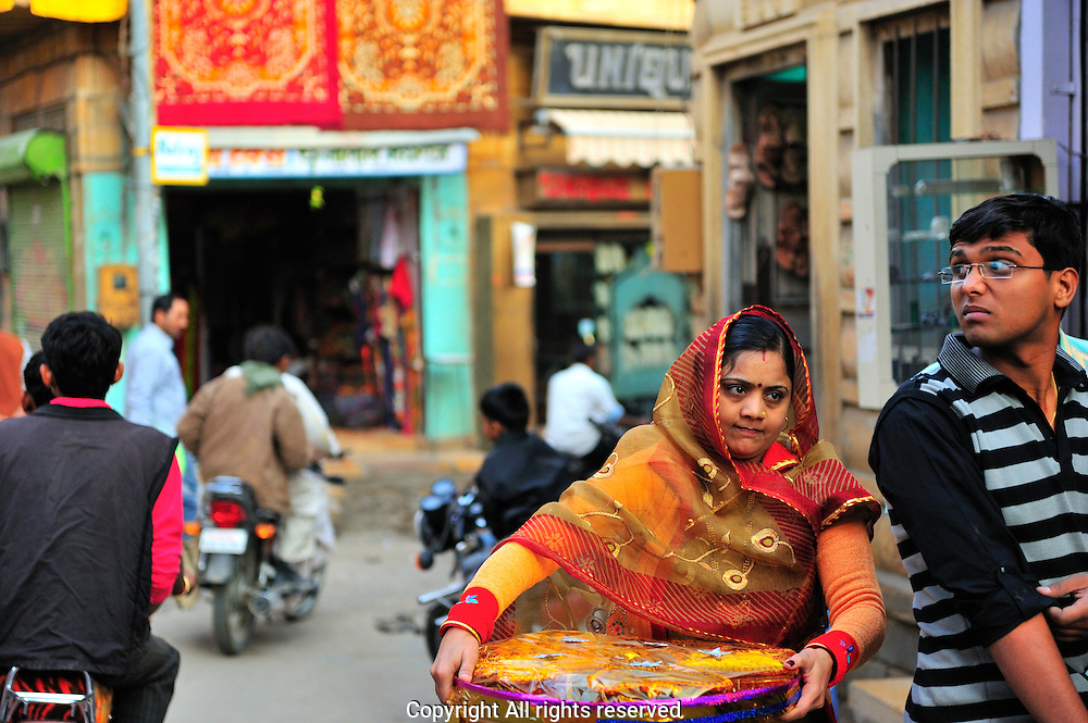 Woman carring gifts in Jaisalmer