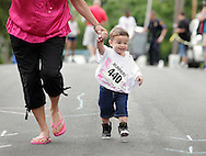 Middletown, New York - A young runner races to the finish line in the Kids Dash at the 15th annual Ruthie Dino Marshall 5K Run and Fun Walk hosted by the Middletown YMCA on Sunday, June 5, 2011. ©Tom Bushey / The Image Works