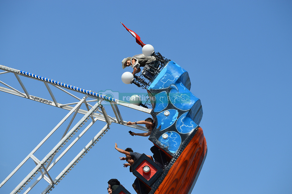 June 26, 2017 - Ankara, Turkey - Families and children enjoy the holiday at the amusement park on the second day of Eid al-Fitr in Ankara, Turkey on June 26, 2017. (Credit Image: © Altan Gocher/NurPhoto via ZUMA Press)