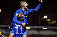 AFC Wimbledon midfielder Mitchell (Mitch) Pinnock (11) and AFC Wimbledon striker Joe Pigott (39) celebrating after scoring goal during the EFL Sky Bet League 1 match between AFC Wimbledon and Burton Albion at the Cherry Red Records Stadium, Kingston, England on 28 January 2020.