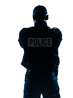 Rear view of an afro American police officer standing isolated on white isolated background
