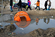 France , Calais, camp for refugees known as 'The Jungle'. November 22nd 2015. Heavy rain has washed out many tents.