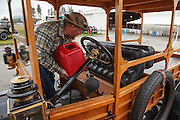 Putting gas in an old Model T, Western Antique Aeroplane and Automobile Museum, Hood River, Oregon.