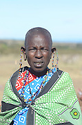 Kenya, Masai Mara, members of the Masai tribe entertain tourists